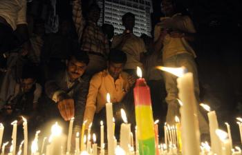 Indians light candles in memory of 2008's terror attack victims outside the landmark Taj Mahal hotel in Mumbai on November 26, 2009. One of the attackers was sentenced to death on Thursday by an Indian court. (Indranil Mukherjee/AFP/Getty Images)