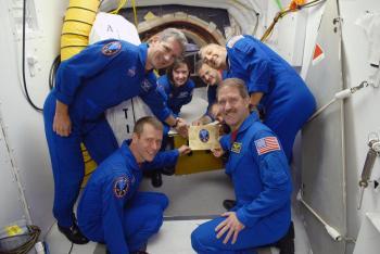 The Atlantis crew: from left are Mission Specialists John Grunsfeld and Michael Good, Pilot Gregory C. Johnson, Commander Scott Altman, and Mission Specialists Mike Massimino, Andrew Feustel and Megan McArthur. (NASA/Kim Shiflett)