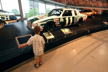 NASCAR HALL OF FAME:A young fan looks at a race car along Glory Road during the NASCAR Hall of Fame's grand opening on May 11 in Charlotte, North Carolina.  (Streeter Lecka/Getty Images for NASCAR Hall of Fame)