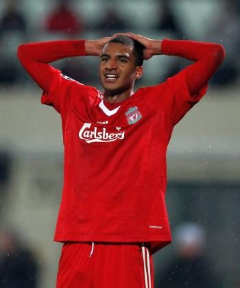 David Ngog and his Liverpool mates were knocked out of the Champions League on Tuesday. (Richard Heathcote/Getty Images)
