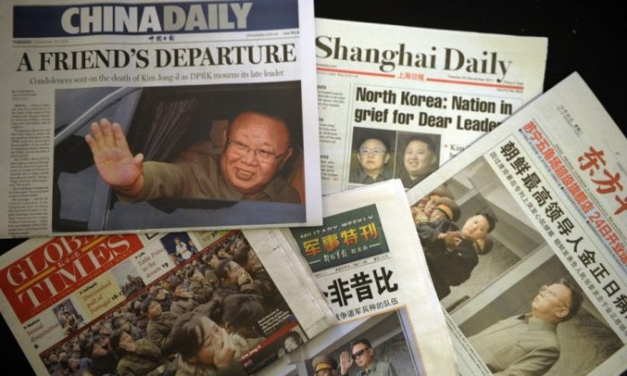 The front pages of selected Shanghai newspapers are seen reporting on the death of North Korean leader Kim Jong Il on Dec. 20. (Peter Parks/AFP/Getty Images)
