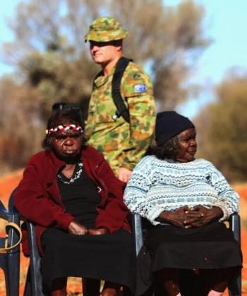 Aboriginal women gather for a meeting on July 6, 2007 at Mutitjulu, near Alice Springs. The Federal Government has restated its support for the Northern Territory intervention  in Indigenous communities. (Ian Walie/Getty Images)