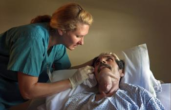 Registered Nurse N. Von Reiter comforts Ramond Garcia as his health quickly declines at the Hospice of Saint John on August 20, 2009 in Lakewood, Colorado. Nursing becoming one of the fastest growing professions in the US. (John Moore/Getty Images)