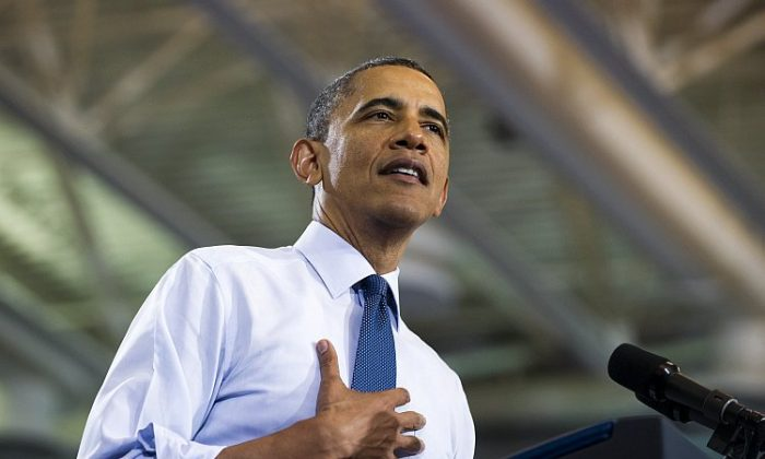 President Barack Obama speaks to junior and senior high school students on the interest rates of federal subsidized student loans at Washington-Lee High School in Arlington, Va., on May 4. Without Congressional intervention, student loan interest rates are set to double on July 1. (Saul Loeb/AFP/GettyImages)