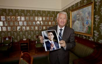 The chairman of the Norwegian Nobel Peace Prize Committee, Thorbjoern Jagland shows a picture of 2009 Nobel peace prize laureate, Barack Obama, after the announcement of the winner in Oslo 9 October 2009.  (Daniel Sannum Lauten/AFP/Getty Images)