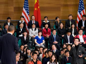 A student asks U.S. President Barack Obama (L) a question during a town hall meeting at the Museum of Science and Technology in Shanghai, on Nov. 16.  (Saul Loeb/AFP/Getty Images)