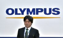 Olympus Sues Executives for Fraud