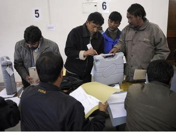 Indian polling officials seal and certify the voting machines after the end of voting at a counting centre in Leh town in Ladakh parliamentary constituency in the northern Indian state of Jammu and Kashmir on May 13, 2009. (Manpreet Romana/AFP/Getty Images)