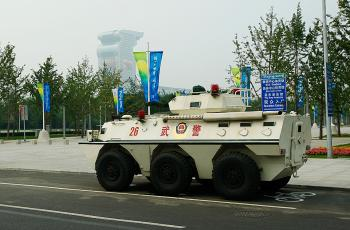 A Chinese military tank sits outside the National stadium prior to the start of the Opening Ceremony for the 2008 Beijing Summer Olympics on August 8, 2008.   (Cameron Spencer/Getty Images)