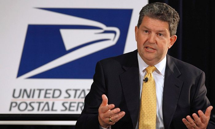 Postmaster General and U.S. Postal Service CEO Patrick Donahoe announces on May 9 a new plan to keep the nation's smallest post offices open despite ongoing budget trouble. In the face of mounting financial losses and debt, the Postal Service's plan would modify retail-window hours and reduce the number of full-time employees instead of closing rural post offices. (Chip Somodevilla/Getty Images)
