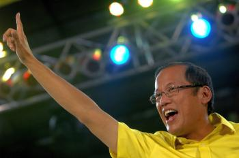 Philippine presidential candidate and senator Benigno 'Noynoy' Aquino, son of democracy icon Corazon Aquino, waves to supporters during a live television show in Manila on May 4. Aquino was the leading candidate in a survey released last week estimating support for him at 39 percent. (Noel Celis/AFP/Getty Images)