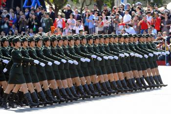 Chinese People's Liberation Army (PLA) women soldiers march past during the National Day parade in Beijing on October 1, 2009. (Goh Chai Hin/AFP/Getty Images)