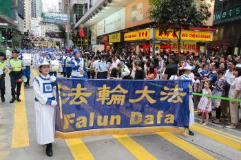 The Tianguo Marching Band delivers 'Quit CCP' message in Hong Kong. (The Epoch Times)