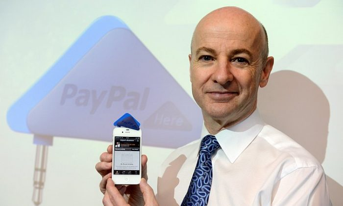 Senior vice president of Asia Pacific for Paypal, Rupert Keeley, poses for a picture with Paypal's triangle-shaped smartphone payment dongle called PayPal Here in Hong Kong, on March 16. (Aaron Tam/AFP/Getty Images)