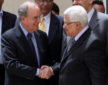 Israel - Palestine Peace Talks: Palestinian president Mahmud Abbas shakes hands with US Middle East envoy George Mitchell upon his arrival for a meeting in Ramallah on May 9. (Abbas Momani/AFP/Getty Images)