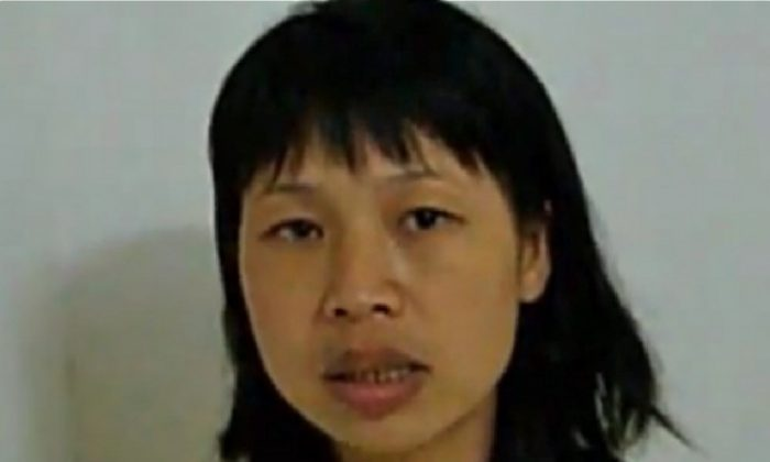 The younger sister of Quan Shuilin. Quan hit a Communist Party official in the neck with a scythe, killing him, after his land was seized. His younger sister uploaded a video pleading for understanding over the impossible situation her brother was put in. (Boxun.com)
