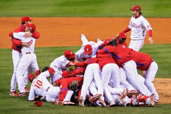 The Philadelphia Phillies pile on top of closing pitcher Brad Lidge #54 after they won 4-3 to win the World Series against the Tampa Bay Rays.  (Michael Heiman/Getty Images)