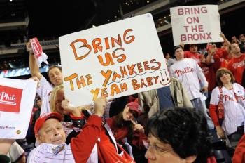 Fans of the Philadelphia Phillies hold up signs which call for the Phillies to play against the New York Yankees in the World Series. (Jeff Zelevansky/Getty Images)