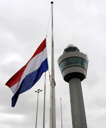 A flag hangs half mast at Amsterdam Schiphol Airport on May 12, 2010, in respect for the casualties of the Libyan Afriqiyah Airways Airbus A330. (Toussaint Kluiters/AFP/Getty Images)