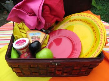 To make your picnic extra special, bring cheese, fresh fruit, a colorful table cloth, and festive napkins and plates. (Maureen Zebian/The Epoch Times)