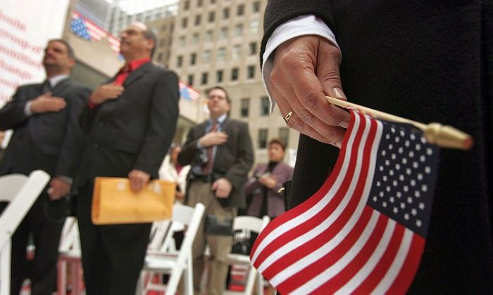 Attendees stand for the Pledge of Allegiance during a swearing-in ceremony for new U.S. citizens in New York City. (Spencer Platt/Getty Images)