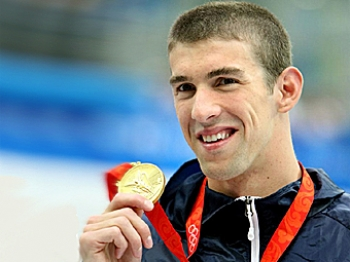 American Michael Phelps, on his way to becoming the greatest Olympian of all time, poses with his gold medal after winning the Men's 200m Freestyle. (Jed Jacobsohn/Getty Images)