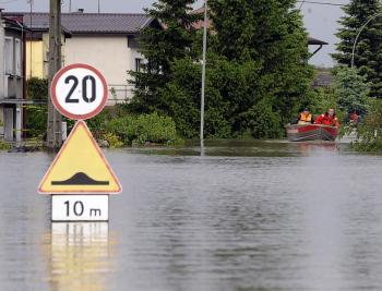 Rescue teammembers make their way in the flooded district of Sandomierz, central Poland, on May 19. Poland Interior Minister Jerzy Miller has accused beavers of being partially to blame that resulted in 15 deaths and nearly 2.5 billion euro.  (Janek Skarzynski/Getty Images)