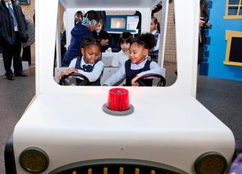 Kindergarten kids from PS 19 enjoy the new Junior Officers Discovery Zone at the New York City Police Museum in Lower Manhattan on Thursday. (Amal Chen/The Epoch Times)