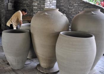Foshan, China - A worker makes a pottery product at the Ancient Nanfeng which was built up in Ming Dynasty (A.D. 1506-1521).  (China Photos/Getty Images)