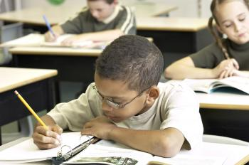 POSITIVE LEARNING: When a child presents a homework assignment, parents should focus on one or two areas that need improvement. (Photos.com)