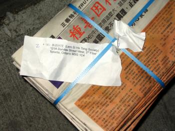 A stack of Crescent Chau's Truth Magazin (sic), distributed nationwide in 2006. The court found Chau's explanation for how he funded the 100,000-copy, no-advertisement, freely distributed pro-communist newspapers unconvincing, saying it was reasonable to state he was acting as an agent of Beijing. (The Epoch Times)