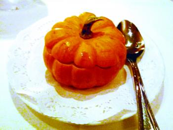 The seasonal pumpkin soup with honeydew melon topped with Amaretto cookies and served in a small round pumpkin (Nadia Ghattas/The Epoch Times)