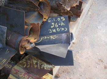 Police collect the wreckage of Qassam rockets that fell on Sderot in one day.  (The Epoch Times)