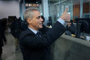 Rahm Emanuel gives a thumbs-up at a produce distribution warehouse where he received the endorsement of Teamsters Joint Council 25 on Jan. 25 in Chicago. Emanuel has been placed back on the Chicago Mayoral ballot after the Illinois Supreme Court issued a stay on an Illinois Appellate Court decision that he didn't meet Chicago residency requirements to run for mayor. (Scott Olson/Getty Images)