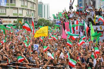 Supporters of President Mahmoud Ahmadinejad celebrate during a rally at Valiasr square on June 14, 2009 in Tehran, Iran. (Majid/Getty Images)