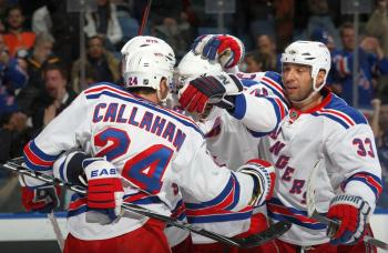 Ryan Callahan celebrates after scoring one of his two goals. He also added two assists. (Bruce Bennett/Getty Images)