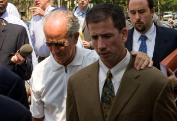 FOUL PLAY: Gerry Donaghy comforts his son, ex-NBA Referee Tim Donaghy, as they leave Brooklyn Federal Courthouse on July 29. Tim Donaghy was sentenced to 15 months of prison for betting on games he refereed.  (Mimi Li/The Epoch Times)