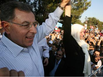 Lebanese Prime Minister Fuad Siniora (L) and Education Minister Bahiya Hariri raise their arms in triumph during a celebration rally on June 8, 2009, following their victory in the general elections. (Ramzi Haidar/AFP/Getty Images)