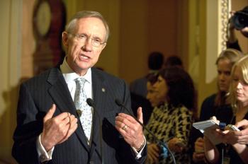 Senate Majority Leader Harry Reid (L) of Nevada speaks to the press on Nov 21. The Senate began debate on health care reform on Monday.  (Nicholas Kamm/AFP/Getty Images)