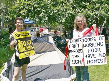 TOUTING REFORM: Mary Tek (L), Real Rent Reform Campaign Manager, and Karen Smith, retired State Supreme Court Justice, advocate for stronger rent laws during the tent city demonstration on May 31 at Church of the Holy Apostles in Manhattan.  (Ivan Pentchoukov/The Epoch Times)