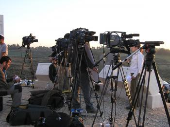 Reporters converge on a hill overlooking Sderot, reporting on the fighting in Gaza.  (The Epoch Times)
