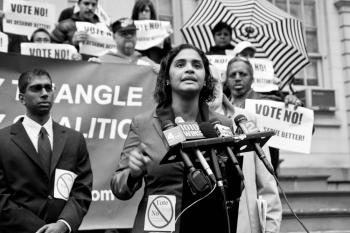 Councilwoman Diana Reyna speaks at a rally at the city hall on Monday, opposing a plan to re-zone 50 acres of urban renewal area in Brooklyn. (Jasper Fakkert/The Epoch Times)