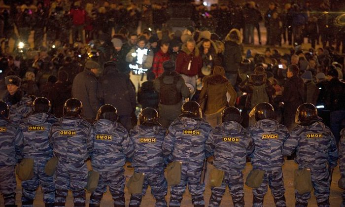 Russian riot police close in on hundreds of opposition activists at Moscow's Pushkin Square on March 5. (John MacDougall/AFP/Getty Images)