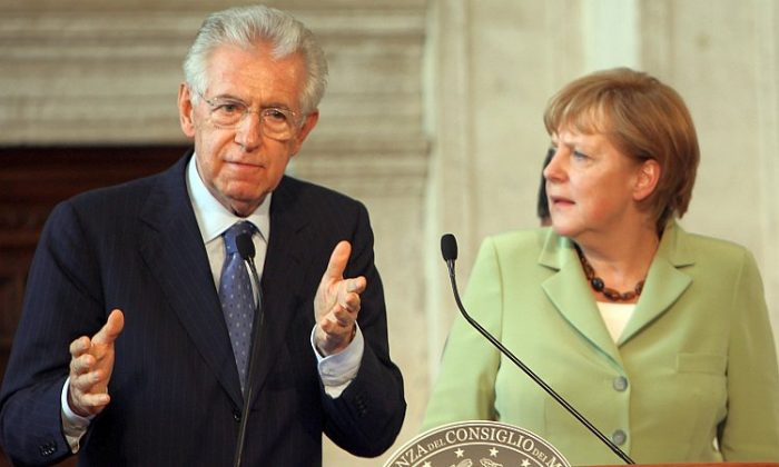 Italian Prime Minister Mario Monti and German Chancellor Angela Merkel answer questions at the end of their meeting last week in Rome. The leaders of Germany, Italy, Spain, and France met in Italy's capital to form a consensus on the handling of Europe's financial crisis ahead of the larger European Union summit June 28 and 29. (Franco Origlia/Getty Images)