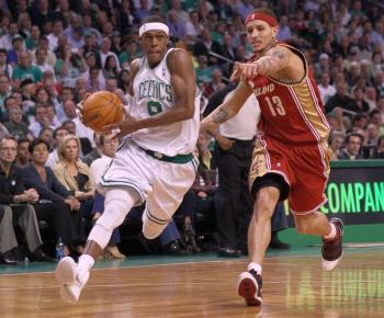 Rajon Rondo drives past Delonte West, leading Boston past top-seeded Cleveland in the Eastern Conference semifinals Game 6 in Boston on Thursday. (Elsa/Getty Images)