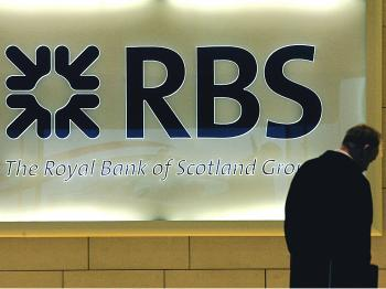 A man walks into the London headquarters of the Royal Bank of Scotland, (RBS) on January 19, 2009.    (Carl De Souza/AFP/Getty Images)