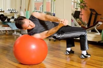 BODY TORQUE: A great exercise for rotational strength. If you�ve never done it before, have someone spot the ball. (Henry Chan/Epoch Times Staff, Space courtesy of Fitness Results)