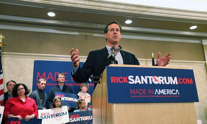 Republican presidential candidate former Massachusetts Gov. Mitt Romney speaks during a campaign rally at Caster Concepts on Feb. 27 in Albion, Michigan. With one day to go before the Michigan and Arizona primaries, Mitt Romney continues to campaign throughout Michigan. (Justin Sullivan/Getty Images)
