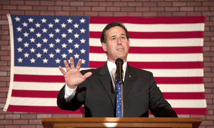 Republican presidential candidate, former U.S. Sen. Rick Santorum speaks to supporters at a Rally for Rick, at Ledgeview Bowling Lanes on March 25, in Fond du Lac, Wis. Santorum is back on the campaign trail following a decisive victory in Louisiana's GOP primary election. (Mark Hirsch/Getty Images)