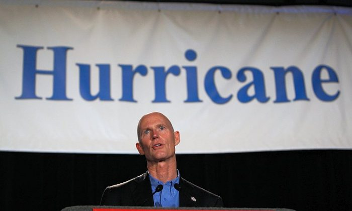 Florida Gov. Rick Scott speaks during the Governor's Hurricane Conference at the Broward County Convention Center on May 16 in Fort Lauderdale, Fla. He asked local residents to be careful and to help warn holiday tourists of storm dangers. (Joe Raedle/Getty Images)